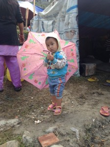 Child of Nepal with umbrella